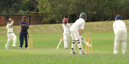 College students playing cricket